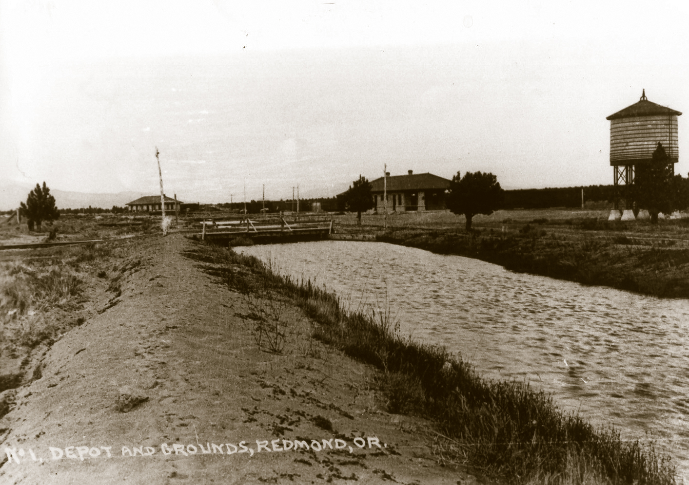 The 1894 Carey Act (allowing private development of irrigation systems on arid federal lands) and the construction of the railroad were key to Redmond's success.