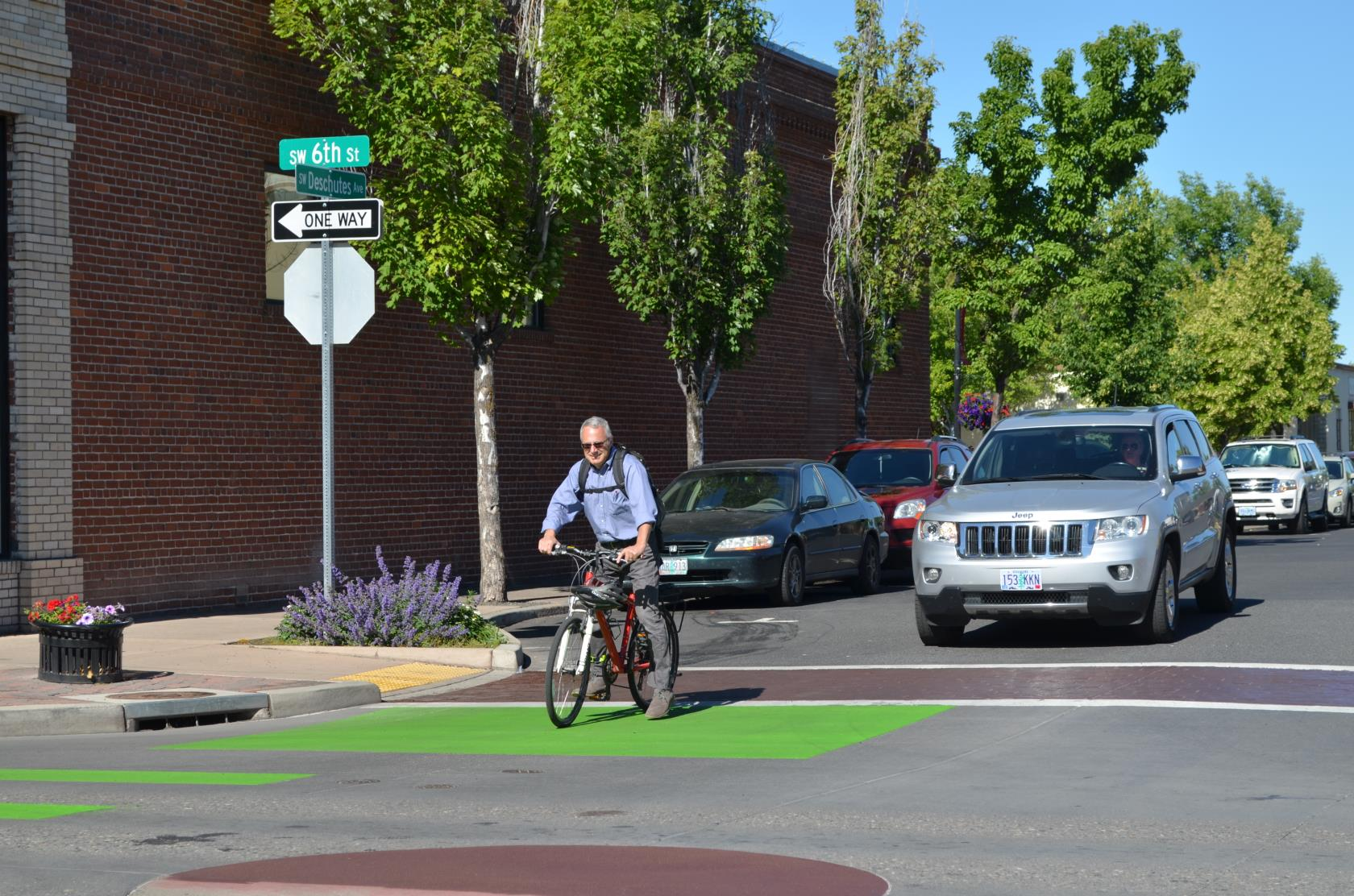 Cyclist waiting in Green Bike Box at Intersection